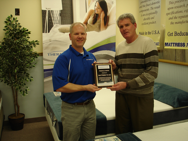 Jeff Scheuer accepting 2012 Therapedic Pinnacle Award plaque.