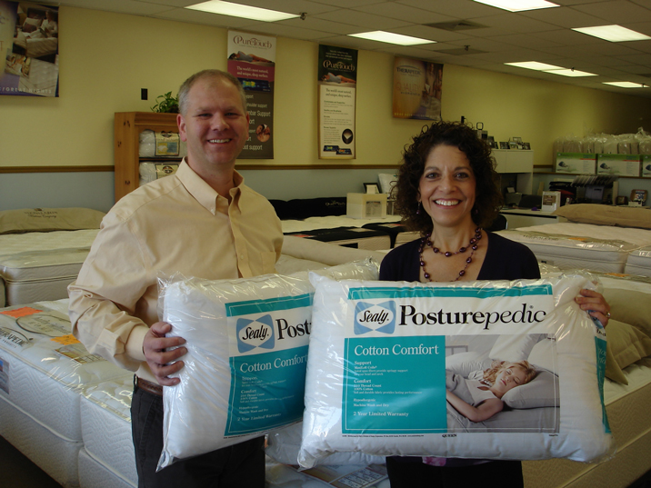 Jeff Scheuer with pillows donated to Turning Point