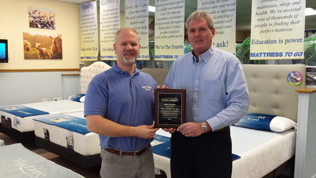 Jeff Scheuer receives 2015 Pinnacle Award plaque from Therapedic's Midwest Sales Manager Timothy Sheaks.