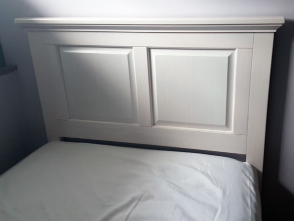 A white headboard donated by Mattress To Go to Abigayle Ministries.