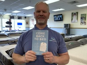 Jeff Scheuer Holding Book Come Back To Bed